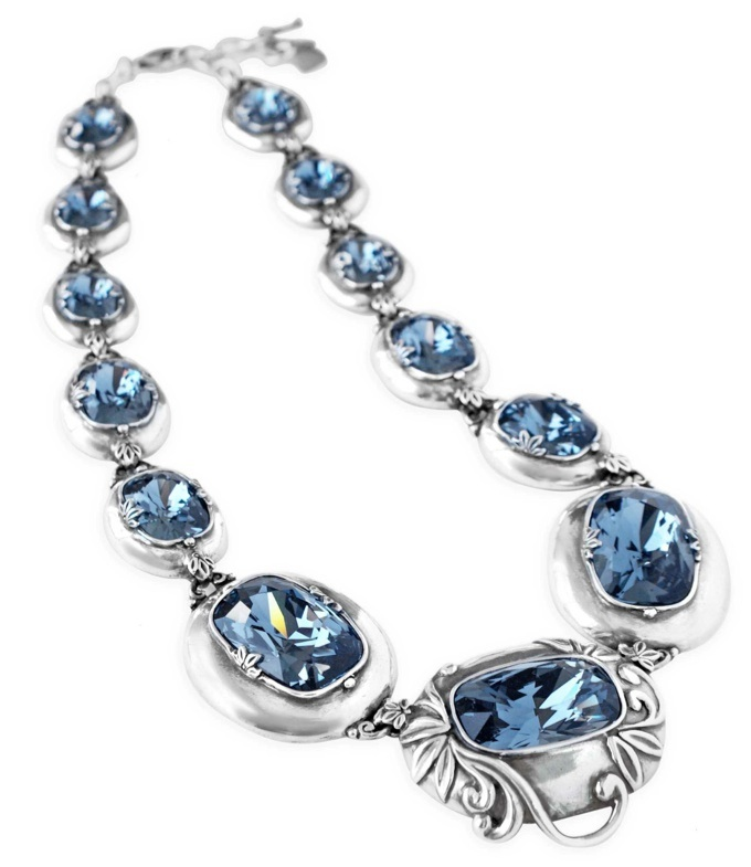 Lily Rose couture necklace featuring spellbinding cushion-cut denim blue Swarovski crystals and burnished silver ethereal accents. Finished with lobster clasp fastening.