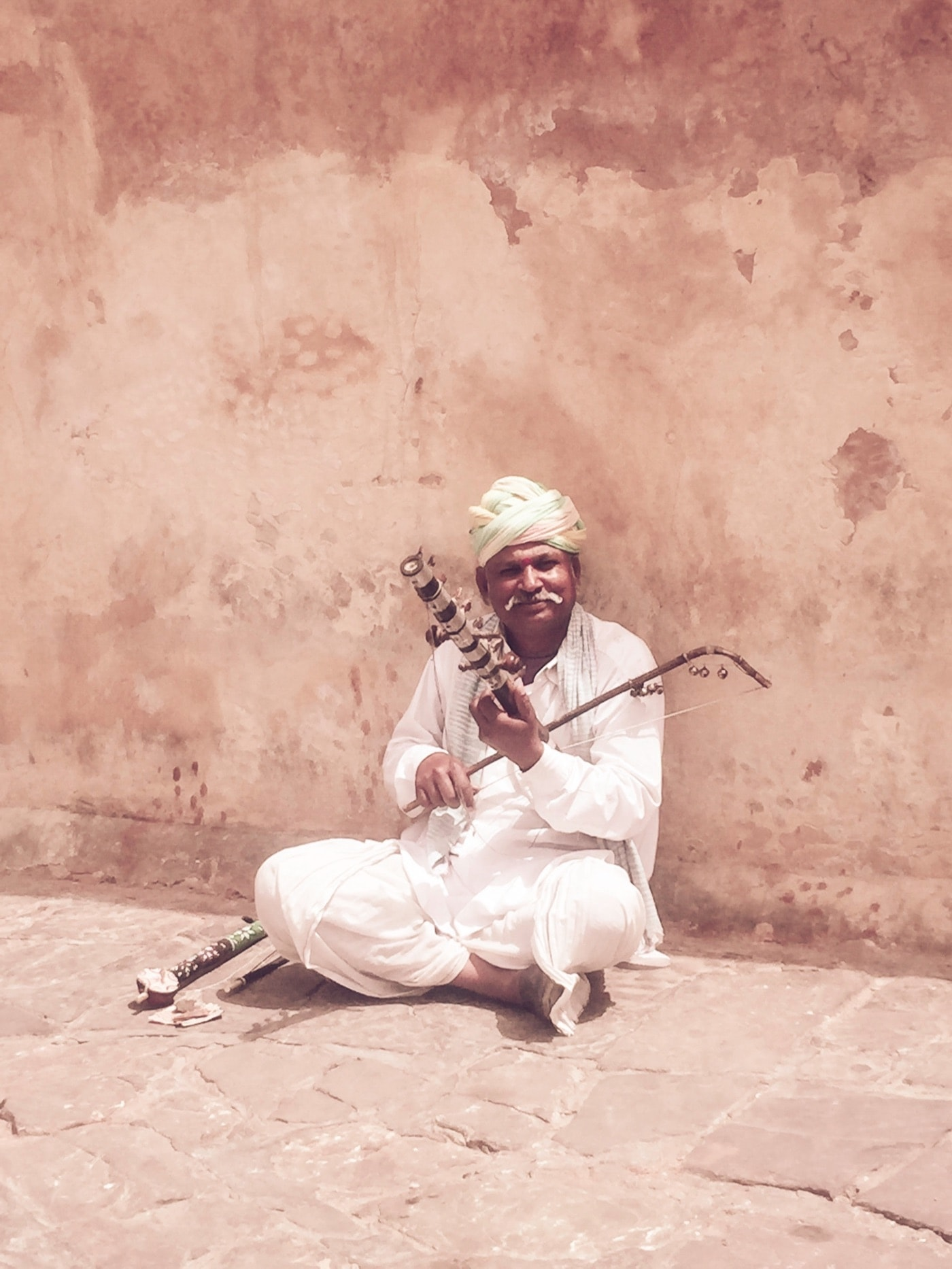 Rajathani Folk Musician Playing the Ektara outside Amber Fort
